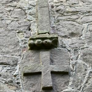 Later period cross and pilaster above the Saxon doorway